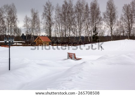 pacified snow park with bench and lanterns - stock photo