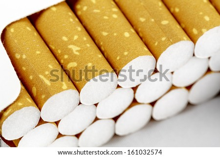 Pack of cigarettes in the box shown up close - stock photo