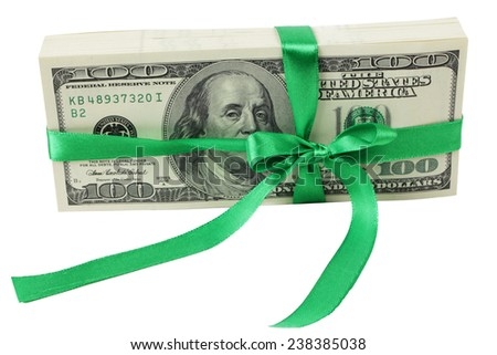 Pack of dollars in a green ribbon on white background on Holiday - stock photo