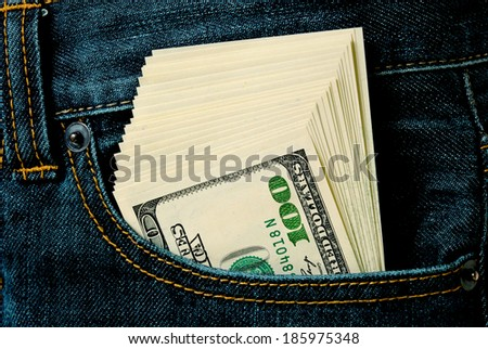 Pack of dollars in a jeans pocket. - stock photo