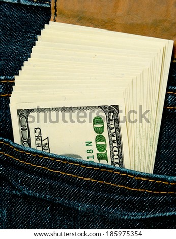 Pack of dollars in a jeans pocket.