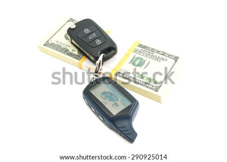 pack of one hundred dollars banknotes and car keys on white