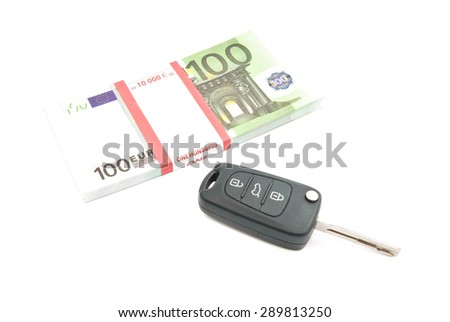 pack of one hundred euros banknotes and car keys on white - stock photo