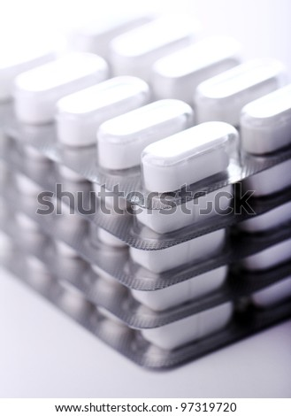 Pack of pills over white backgound - stock photo