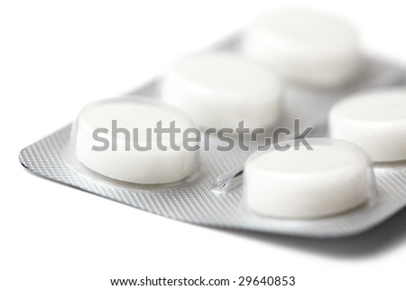 Pack of white pills isolated on white. Closeup.