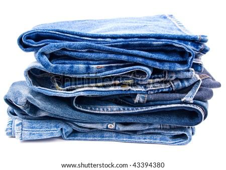 pack of worn blue jeans isolated on white