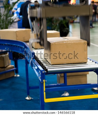 package boxes on industrial conveyor line.  - stock photo