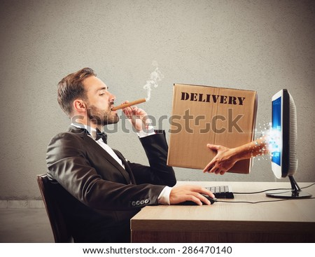Package delivered coming out of the pc - stock photo
