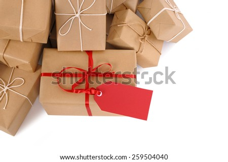 Package, gift : pile of brown parcel, red tag isolated - stock photo