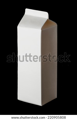 Package of milk on a black background