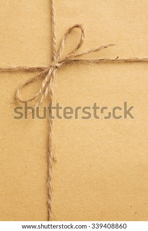 Package tied up with string and a plain label.