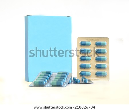 Package with blue vitamin tablets on the white background - stock photo