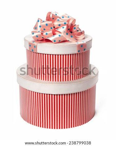 Packaging gift boxes. Wedding & Happy Birthday concept / studio photo of red and white box wrapping ribbon with bowknot - on white background  - stock photo