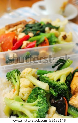 Packed Chinese set lunch or dinner with variety of colorful vegetables. Suitable for food and busy lifestyle, healthy eating and diet and nutrition concepts. - stock photo
