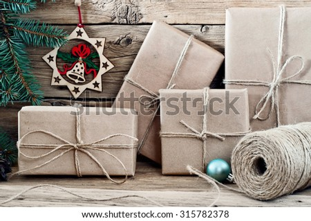 Packed Christmas presents closeup on wooden background. - stock photo