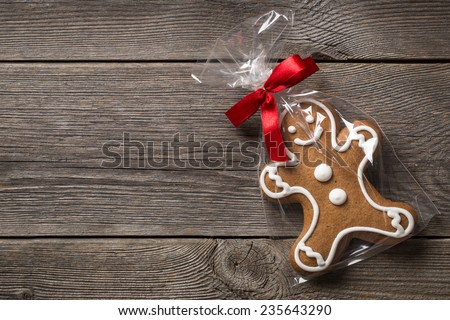 Packed gingerbread cookie on wooden background  - stock photo