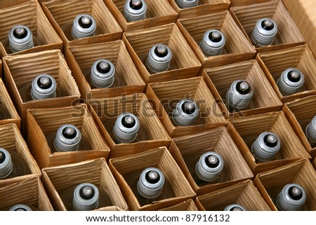 Packed rows of light bulbs in a cardboard box - stock photo
