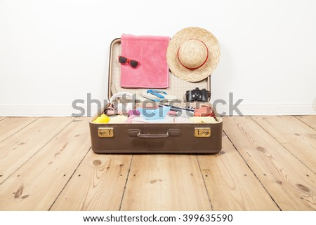 Packed suitcase - stock photo