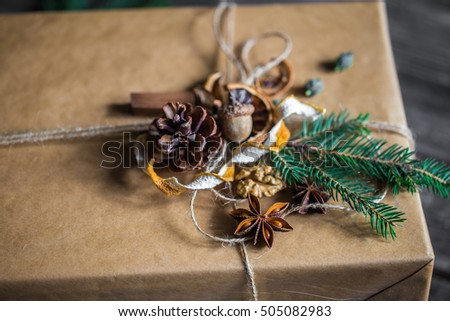 Packed with the box, beautifully Packed with gift on wooden background, holiday concept