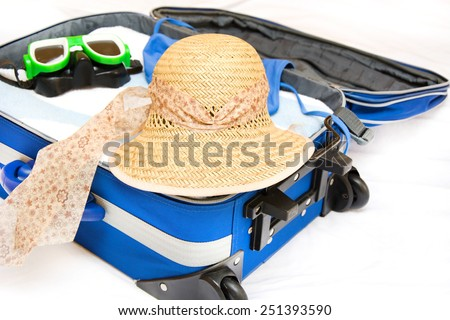 Packing a suitcase for summer - stock photo