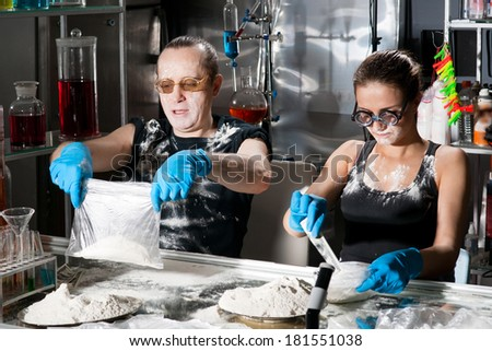 Packing of white powder in packets - stock photo