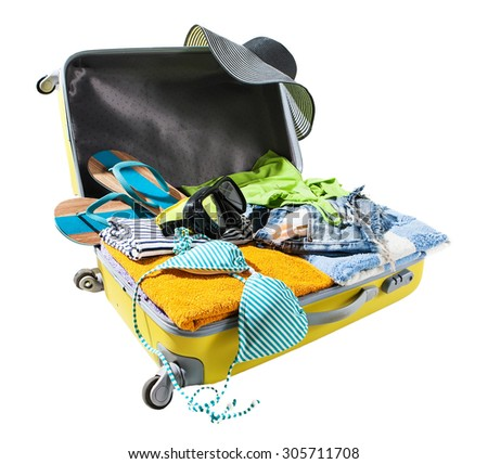 packing suitcase for vacations - stock photo
