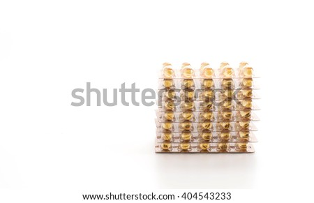 packings of pills and capsules of medicines on white background