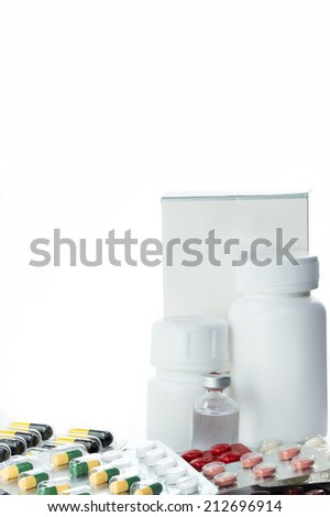 Packs of pills and blank medicine bottle use for medical background