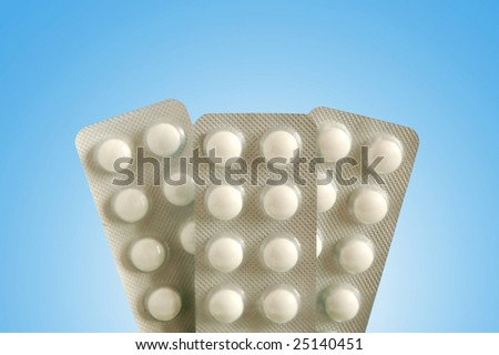 Packs of tablets on bluebackground