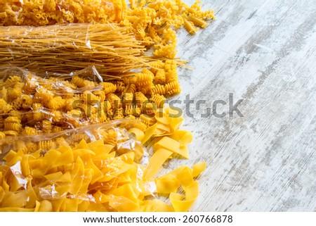 Packs of variety of egg pasta background  - stock photo