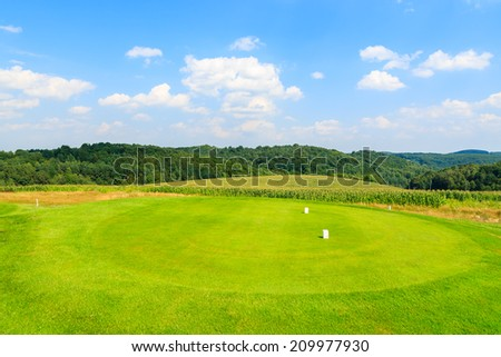PACZULTOWICE GOLF CLUB, POLAND - AUG 9, 2014: golf course green play area in Paczultowice village on sunny summer day, Poland. Golfing is becoming a popular sport among wealthy people from Krakow.