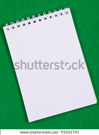 Pad of paper to take notes. Photo on a colored background - stock photo