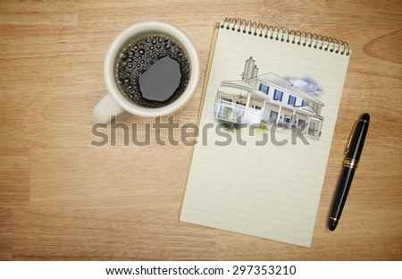 Pad of Paper with House Drawing, Pen and Coffee on Wood Background. - stock photo