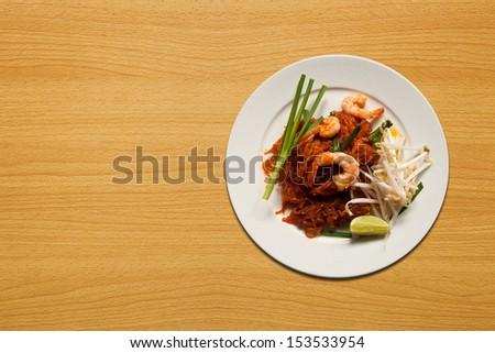 Pad Thai on wood table - stock photo