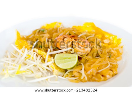 Pad Thai ( Stir Fried Rice Noodle in Thai tradition style  ) ,with fresh shrimp closeup isolated on white background - stock photo