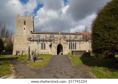 PADBURY, ENGLAND - 3RD MARCH 2015: The outside of an old english church during the day.
