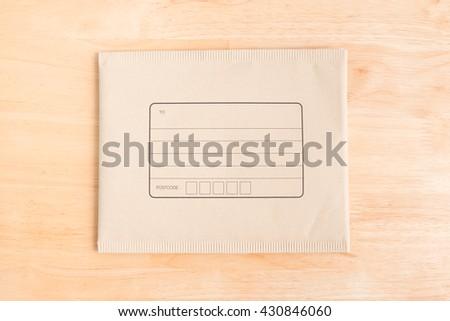 padded mailing envelopes on wood background - stock photo