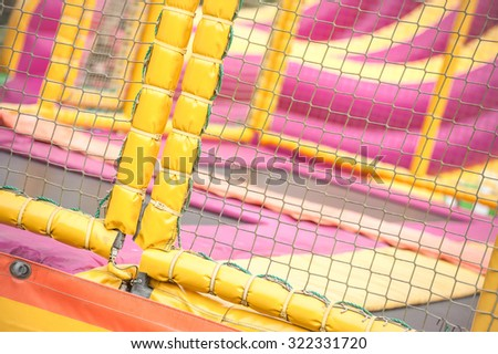padded protection surrounding an adventure trampoline playground - stock photo