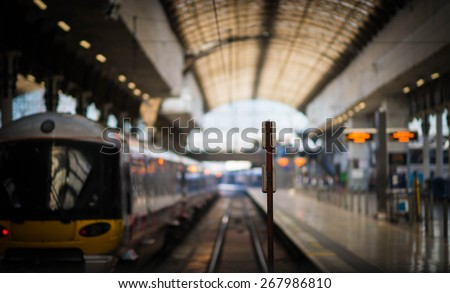 Paddington train station with a train about to leave while the next train waits to come in. - stock photo