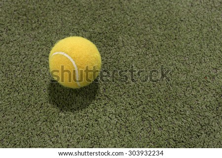 Paddle ball in astroturf court  - stock photo