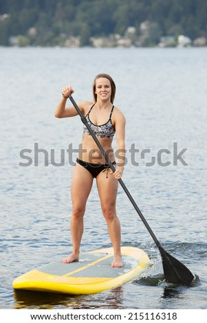 Paddle board session - stock photo