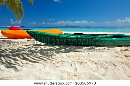 Paddle boats are on sandy beach, Maldives