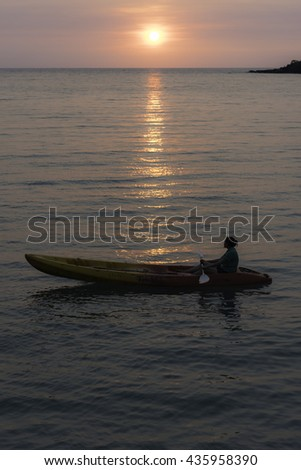 paddle kayak on the sea during sunset