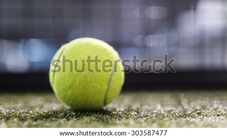 Paddle tennis balls in court with night ambient light and narrow deep of field.