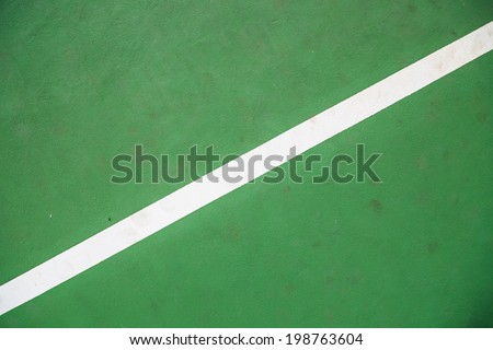 Paddle tennis green hard court texture with white line can used as soccer or badminton background,Green running track rubber cover.  - stock photo