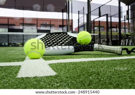 Paddle tennis objects on grass background - stock photo