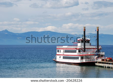 Paddle wheel boat docked on a lake