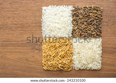paddy rice,brown rice,white rice on wood background - stock photo