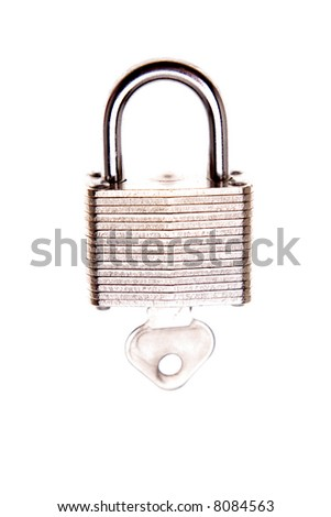 Padlock and key isolated over white
