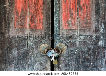 padlock and old door hasp and door on an vintage - stock photo